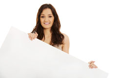 Young woman holding empty banner in hands. Stock Images