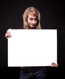 Young woman holding empty billboard Royalty Free Stock Photography
