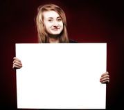 Young woman holding empty billboard Royalty Free Stock Photos