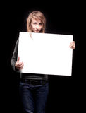 Young woman holding empty billboard Royalty Free Stock Image
