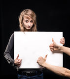 Young woman holding empty billboard Stock Photography