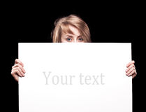 Young woman holding empty billboard Stock Photo