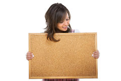Young woman holding an empty board. And smiling, isolated over white background Royalty Free Stock Photography