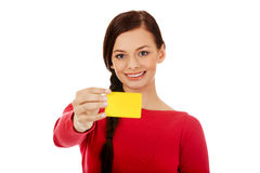 Young woman holding empty business card Stock Images