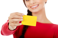 Young woman holding empty business card Stock Image