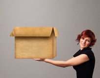 Young woman holding an empty cardboard box Royalty Free Stock Photo