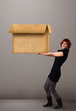Young woman holding an empty cardboard box Royalty Free Stock Images