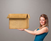Young woman holding an empty cardboard box Royalty Free Stock Photos