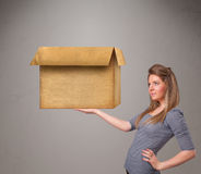 Young woman holding an empty cardboard box Stock Images