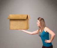Young woman holding an empty cardboard box Royalty Free Stock Image