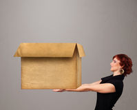 Young woman holding an empty cardboard box Stock Photography