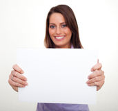 A young woman, holding an empty paper Royalty Free Stock Photo