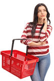 Young woman holding an empty shopping royalty free stock photo