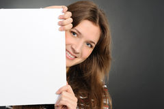 Young woman holding empty white board Stock Image
