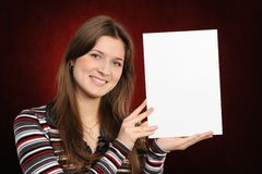 Young woman holding empty white board Royalty Free Stock Photography