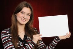 Young woman holding empty white board Stock Images
