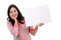 Young woman holding empty white board Royalty Free Stock Photos