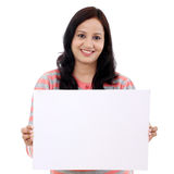 Young woman holding empty white board Royalty Free Stock Image