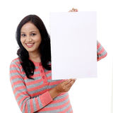 Young woman holding empty white board Royalty Free Stock Images