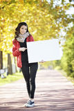 Young woman holding empyt billboard Stock Image
