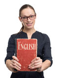 Young woman holding English textbook Royalty Free Stock Photography