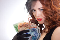 Young woman holding euro money Royalty Free Stock Images