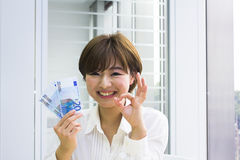 Young woman holding Euros stock images
