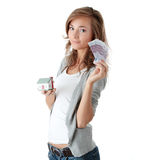 Young woman holding euros bills and house model Stock Images