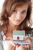 Young woman holding euros bills and house model Royalty Free Stock Photo