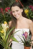 Young woman holding exotic potted plants Stock Image
