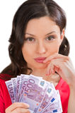 Young woman holding a fan of euro bills Royalty Free Stock Photos