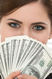Young woman holding fan of hundred dollar bills portrait Royalty Free Stock Photos