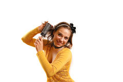 Young woman holding fashion accessories. Modern looking young woman looking at the camera Stock Images