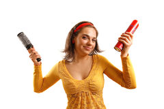 Young woman holding fashion accessories. Modern looking young woman looking at the camera Royalty Free Stock Photo