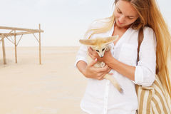 Young woman holding fennec fox. In her hands during traveling in Sahara Royalty Free Stock Photo