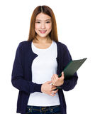 Young woman holding a file Stock Photos