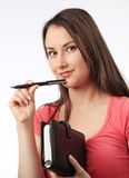 Young woman holding a filofax. And pen Stock Image
