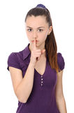 Young woman holding finger to lips Stock Photo