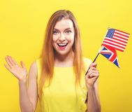 Young woman with flags of English speaking countries. Young woman holding the flags of English speaking countries royalty free stock photo
