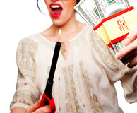 Young Woman holding a flame against money Stock Images