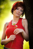 Young Woman Holding Flower Stock Images
