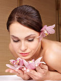 Young woman holding flower. Royalty Free Stock Photos