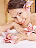 Young woman holding flower. Royalty Free Stock Images