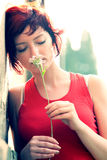 Young Woman Holding Flower royalty free stock image