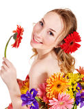 Young woman holding flower. Stock Photography