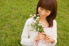 Young woman holding flower. Young woman smiling with flower bouquet Stock Photography