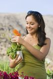 Young Woman Holding Flower Plant Stock Photo