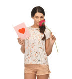 Young woman holding flower and  postcard Royalty Free Stock Photography