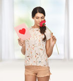 Young woman holding flower and  postcard Stock Photo