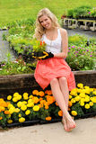 Young Woman Holding Flowers Stock Images